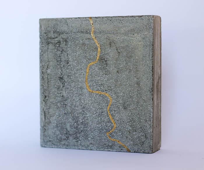concrete, gold leaf by Birgit Moffatt