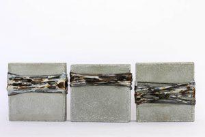 concrete, sting, tar, wax by Birgit Moffatt